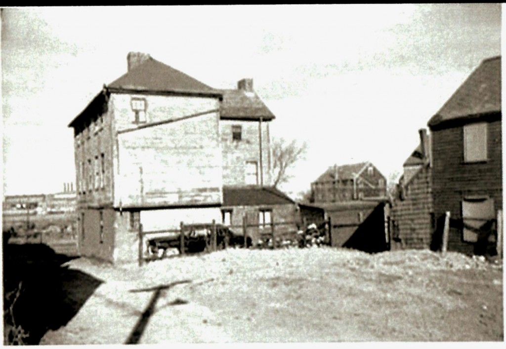 view of jefferson house showing driveway and fence location